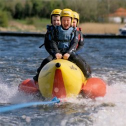 Children ride banana boat