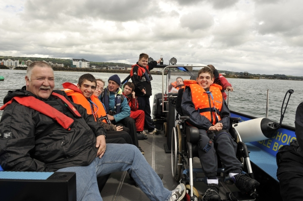 Belfast Lough Sailability Chairman Jim Boyd on the Sea Rover with members of Belfast Lough Sailability