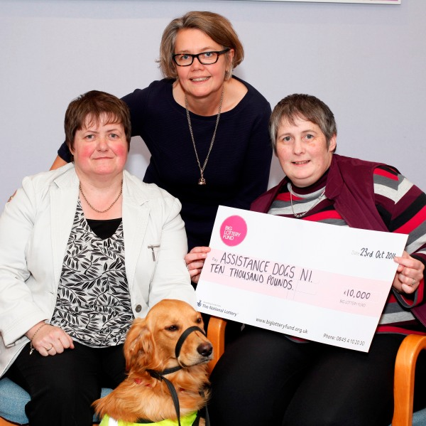 Assistance Dogs NI celebrate winning £10,000 with Joanne McDowell, Big Lottery Fund NI Director