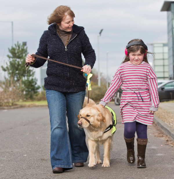 Rebecca and mum Michelle Barker from Cullybackey with their assistance dog Honey