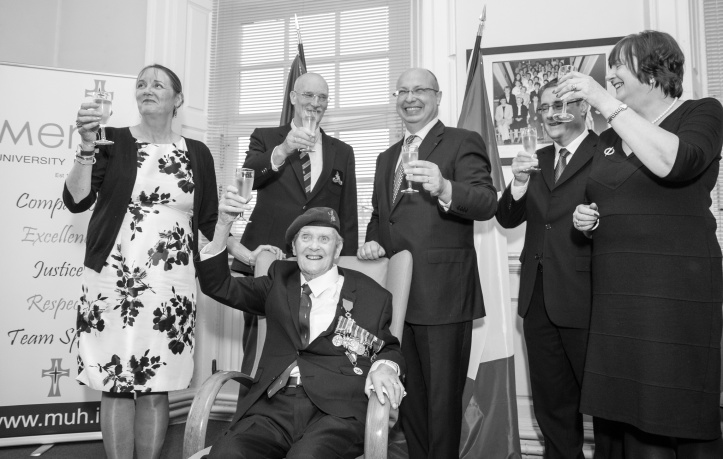 Pat celebrating with his children, (left to right) Mary, Robin, Gerard and Patrica as he received the honour from French Ambassador Jean-Pierre Thebault (centre, rear) at Mercy Hospital in Cork