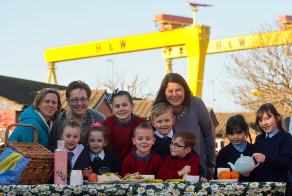 (l-r) Jackie Upton, Jacqui O'Donnell and The Big Lunch's Grainne McCloskey along with children from both side of the interface, from St Matthew's Primary School and Victoria Park PS.