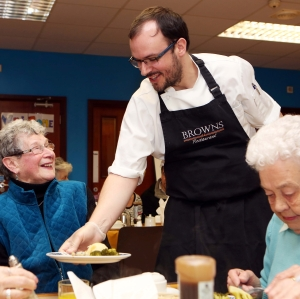Chef Ian Orr serves up a surprise dish to his grandmother Iris Orr who attends the National Lottery-funded Caw Golden Years Luncheon Club in Derry. The National Lottery Old is Gold campaign celebrates funding for organisations working with older people.