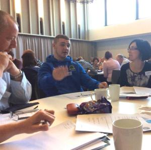 Conor Largey from Ardoyne  Youth Club co-facilitates table discussions with Jane McDowell from the Big Lottery Fund