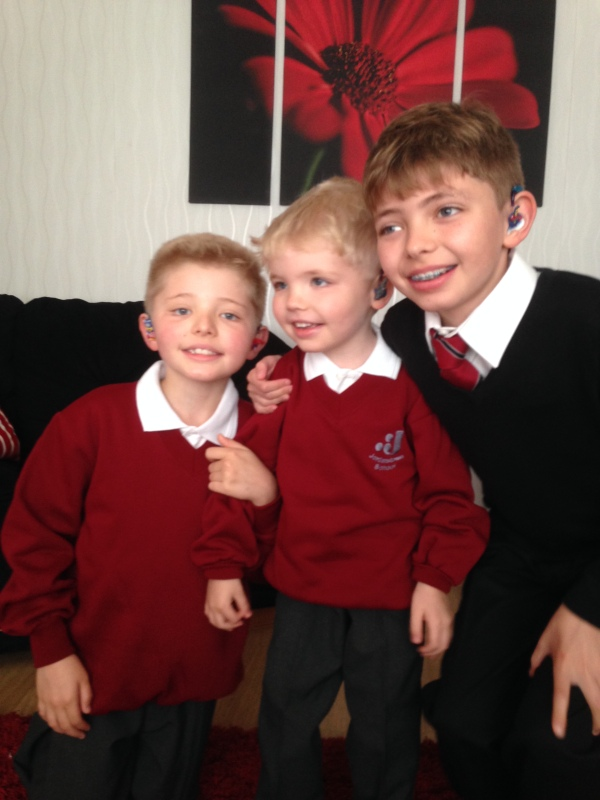 Dean, Carter and Rhys Newbronner, who, with their family, are benefitting from the Action Deaf Youth project.
