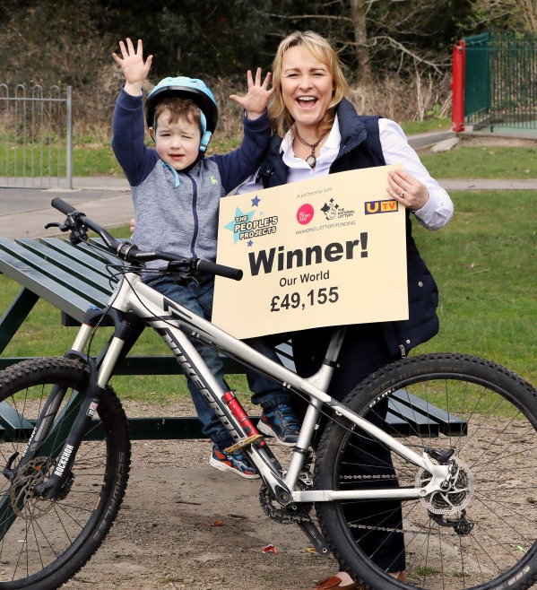 Dylan McShane (4) and Jennifer Cumming from MAC NI celebrate after the Rostrevor group won £49,155 in the Big Lottery Fund's People's Projects competition. They will use the money to run educational and outdoor activities to support children and young people with autism spectrum disorders and their families