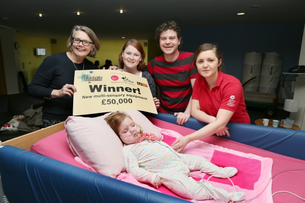 From left, Big Lottery Fund's Joanne McDowell with Laura McGurk and Shane Donaghy with their daughter Layla (19 months) and Northern Ireland Children's Hospice staff nurse Bethany Lucas (red T shirt). The family have been supported by the Northern Ireland Children's Hospice who have just won £50,000 in the People's Projects competition to make improvements to the multi sensory room in their Newtownabbey centre