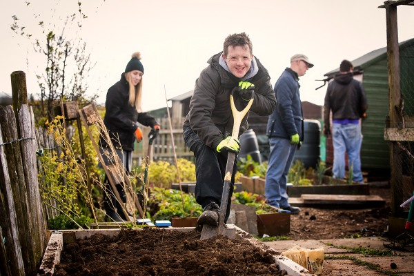 Conor Boyle enjoying working in the allotments