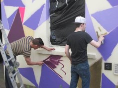 Jason working on the graffiti wall in the court yard.