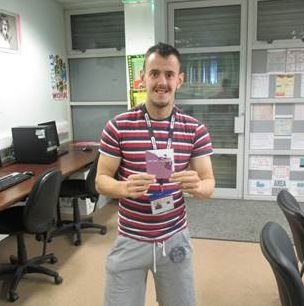Jason receiving a Tesco voucher for being student of the month, when he was studying for his Essential
