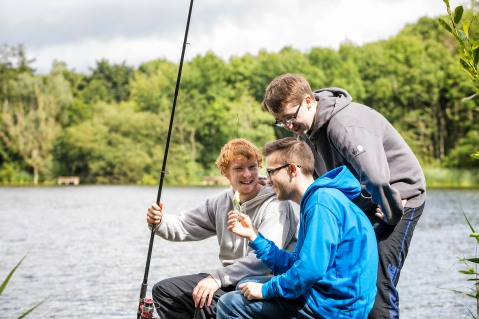 L-R Walter Woods, Matthew Leonard and Jack Fearon chatting while fishing