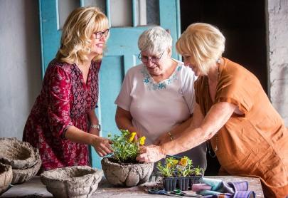 Moya with volunteer Jean Wylie and mum Carol